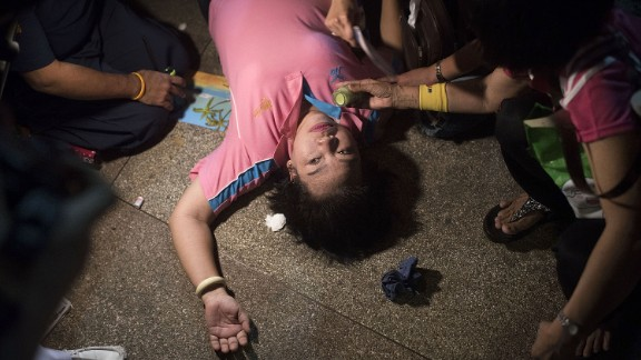 A woman passes out after an official statement announces the death of the king.