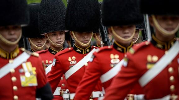 The Thai Royal Guard marches in honor of Thai King Bhumibol Adulyadej on Friday.