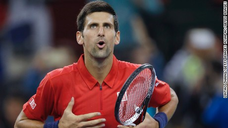 Novak Djokovic celebrates after defeating Mischa Zverev at the Shanghai Masters.