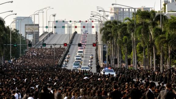 A motorcade carries the body of Thai King Bhumibol Adulyadej