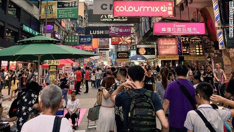 Hong Kong's cosmopolitan streets and markets are awash with color and life.