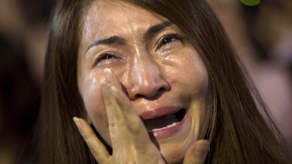 A women cries after learning of the King