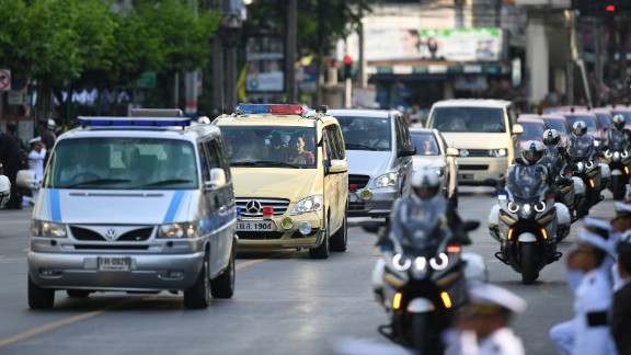 Amid a procession of vehicles, a van carries the body of the King to his palace in Bangkok on Friday.