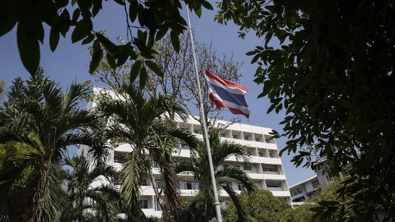 A flag flies at half-staff outside a government hospital on October 14 in Chiang Mai, Thailand. According to a palace statement, all government buildings will fly the Thai flag at half-staff for 30 days starting on Friday.