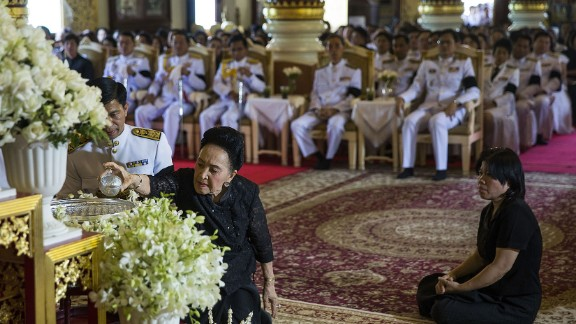 Dignitaries participate in a ceremony commemorating the King at Wat Phra Singh on Friday in Chiang Mai.