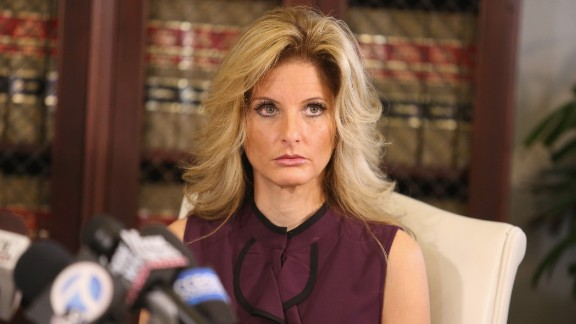 LOS ANGELES, CA - OCTOBER 14:  Summer Zervos, a former candidate on The Apprentice season five, who is accusing Donald Trump of inappropriate sexual conduct, speaks to the press with her attorney Gloria Allred October 14, 2016 in Los Angeles, California.  This is the first time the accuser has spoken publicly about the alleged incident.  (Photo by Frederick M. Brown/Getty Images)