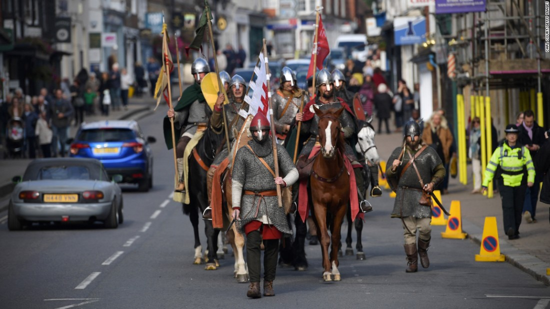 People don armor and period costumes as they finish a march from York in central England ahead of the re-enactment of the 1066 Battle of Hastings on Friday, October 14, in Battle, East Sussex. Re-enactors gathered at the Battle Abbey site over the weekend to mark the 950th anniversary of one of the most famous battles in English history. William, the Duke of Normandy, and his Norman forces from France defeated the English army under King Harold II, the last Anglo-Saxon ruler in England. William's victory marked the beginning of the Norman conquest and would transform England.