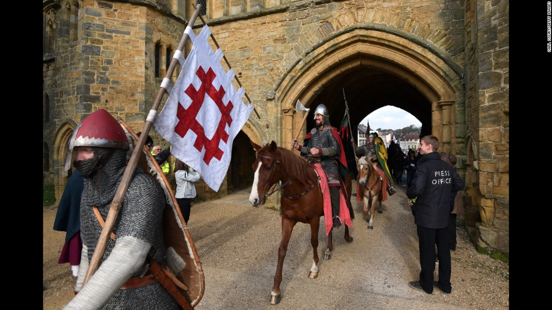 Re-enactors make their way through the entrance to Battle Abbey on October 14. The Battle of Hastings marked the last successful invasion of England.