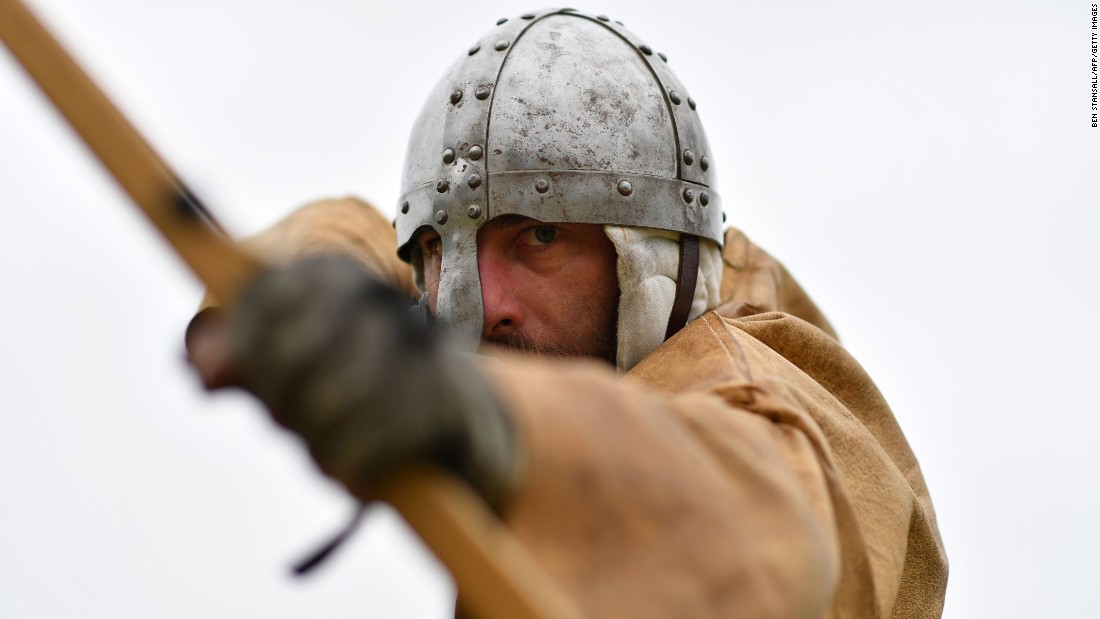 A re-enactor takes aim with his arrow.