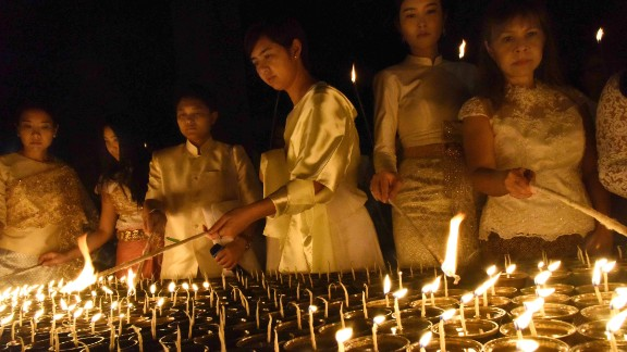 Devotees light candles for the late Thai King  at Mahabodhi temple in Bodhgaya on October 14.