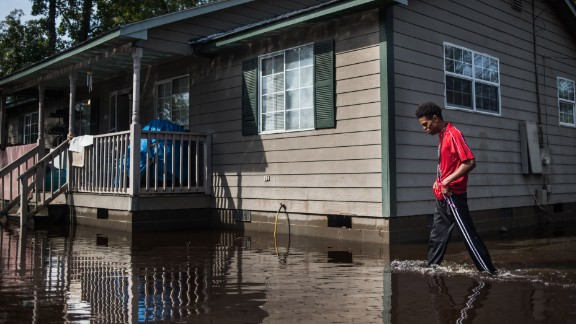 Jibrail Freeman walks to his flood-damaged home on Saturday, October 15, in Lumberton, North Carolina. A week after Hurricane Matthew hit North Carolina, flooding is still a major problem for residents. The storm caused 26 deaths in the state.