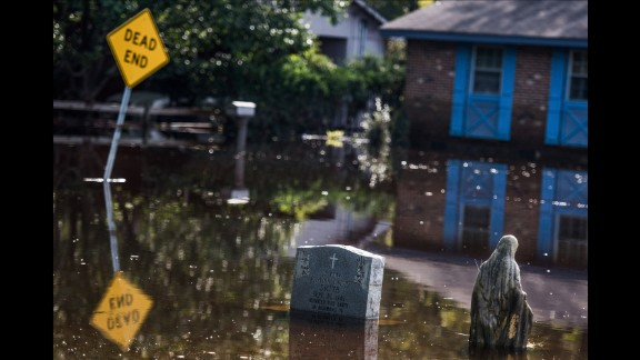 A Lumberton graveyard is inundated with floodwaters from the Lumber River.