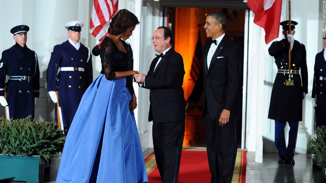 US President Barack Obama and first lady Michelle Obama welcome French President Francois Hollande as he arrives for a state dinner at the White House on February 11, 2014.
