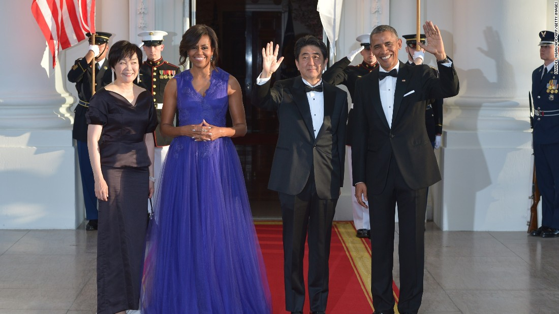 US President Barack Obama and first lady Michelle Obama greet Japanese Prime Minister Shinzo Abe and wife Akie Abe upon arrival at the White House on April 28, 2015.