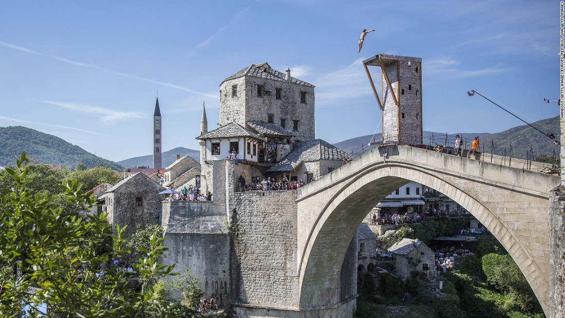 "<a href=""http://cnn.com/2013/10/23/sport/orlando-duque-cliff-diving-colombia/"" target=""_blank"">Veteran Colombian diver Orlando Duque</a> dives from the famous 16th century Mostar Bridge in Eastern Europe. Having stood for 427 years, the bridge was destroyed in 1993 during the Croat-Bosniak War, but reconstructed by 2004."