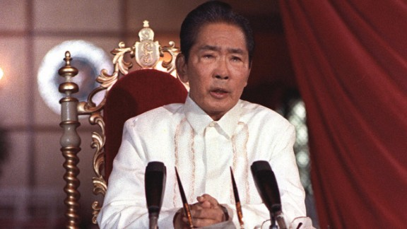 """Manila, PHILIPPINES:  TO GO WITH """"PHILIPPINES-MARCOS-ANNIVERSARY"""" (FILES) This file photo dated 24 February, 1986 shows Philippines President Ferdinand Marcos holding a press conference in Manila at the Malacanang Presidential Palace that the country is in state of emergency an that he would take over public utilities including television and radio stations.  Ferdinand Marcos transformed the Philippines from a promising democracy to a basket-case dictatorship, but as 25 February 2006 marks 20 years after his fall from power, surprisingly few people have bitter memories of him.   AFP PHOTO/FILES  (Photo credit should read TOLEDO/AFP/Getty Images)"""