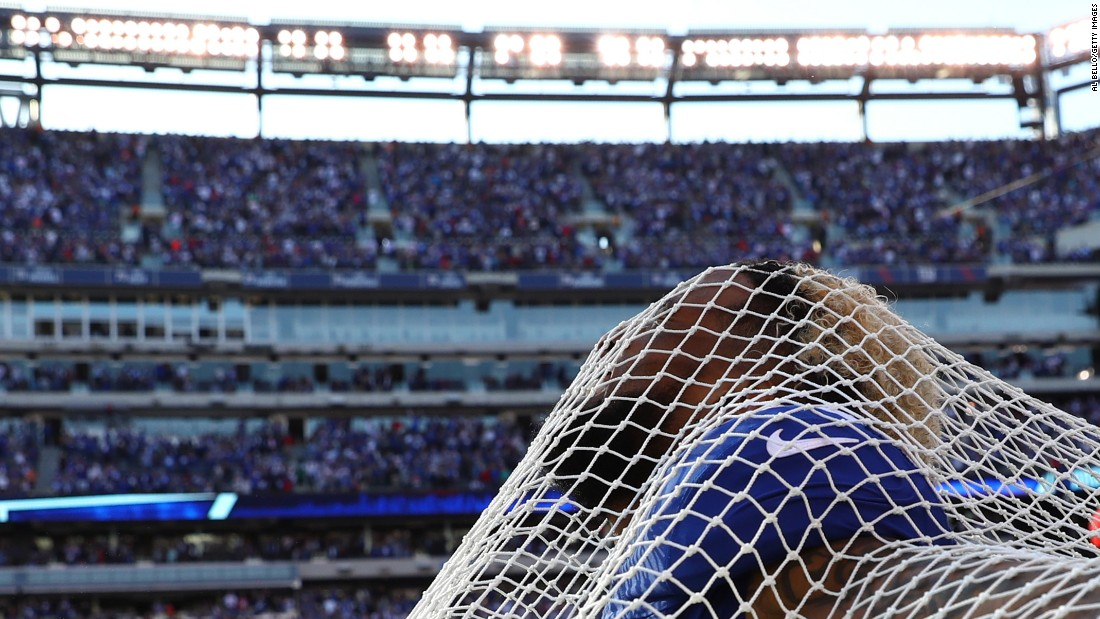"New York Giants wide receiver Odell Beckham sticks his head through a sideline kicking net after scoring the go-ahead touchdown against Baltimore on Sunday, October 16. Beckham and the net have had <a href=""http://nypost.com/2016/10/16/odell-beckham-takes-the-plunge-with-kicking-net/"" target=""_blank"">an interesting relationship,</a> to say the least. Beckham attacked the net in anger three weeks ago, and then he hugged the net to ""make up"" last week. This time around, he even got on one knee in a mock proposal."