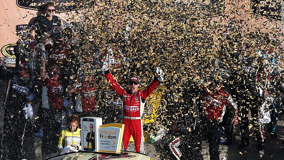 NASCAR driver Kevin Harvick celebrates after winning the Sprint Cup race at Kansas Speedway on Sunday, October 16.