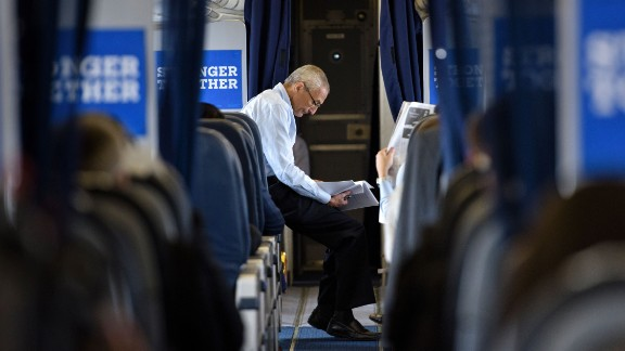 John Podesta, Clinton Campaign Chairman, reads over notes on board Clinton's plane at Westchester County Airport on September 27, 2016 in White Plains, New York.