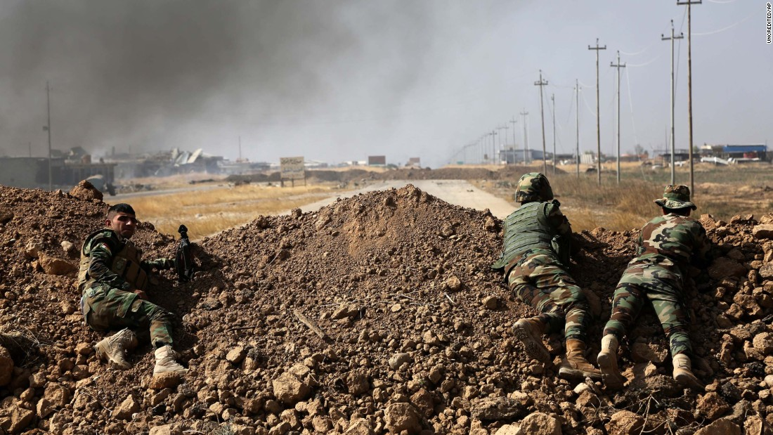Kurdish security forces take up a position near ISIS-controlled villages on Monday, October 17.