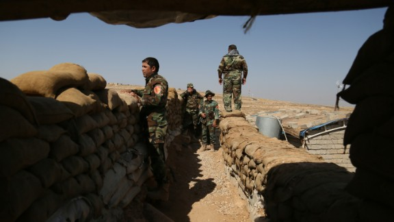 Peshmerga forces are seen at Naveran front during an operation in Nineveh, Iraq on Tuesday.
