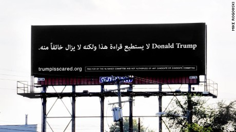 "A billboard in Dearborn, Michigan reads ""Donald Trump can't read this, but he's afraid of it anyway"" in Arabic."