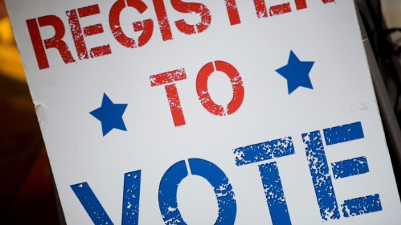 A voter registration sign is seen before a viewing event for the first Presidential Debate between Donald Trump and Hillary Clinton at the Harvard University Kennedy School of Government on September 26, 2016, in Cambridge, Massachusetts.