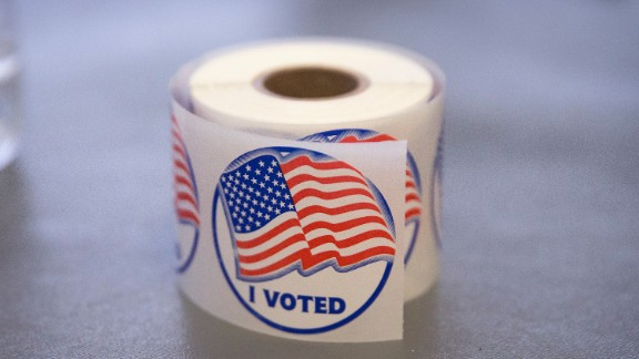 "A roll of ""I Voted"" stickers, which are handed out to residents after they vote, sit on an election officials table at a polling place on November 4, 2014 in Ferguson, Missouri.  In last Aprils election only 1,484 of Ferguson"