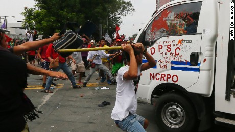 Protesters hit a Philippine National Police van after it rammed into protesters outside the U.S. Embassy in Manila Wednesday, Oct. 19, 2016. The police van rammed into protesters, leaving several bloodied, as an anti-U.S. rally turned violent Wednesday at the embassy. The protesters, consisting of students, workers and tribespeople, were demanding an end to the presence of visiting U.S. troops in the Philippines and to support a call by President Rodrigo Duterte for a foreign policy not dependent on the U.S., the country's longtime treaty ally. (AP Photo/Bullit Marquez)