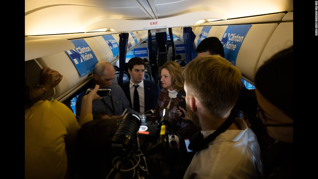 Clinton's campaign staff takes questions from the media on her plane in Seattle on October 14.