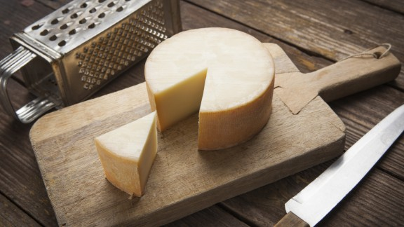 Tyramine, a monoamine compound found in aged and fermented foods, has been linked to migraines. The compound is produced naturally in foods from the breakdown of the amino acid tyrosine and can be found in foods such as aged cheeses or cured meats.