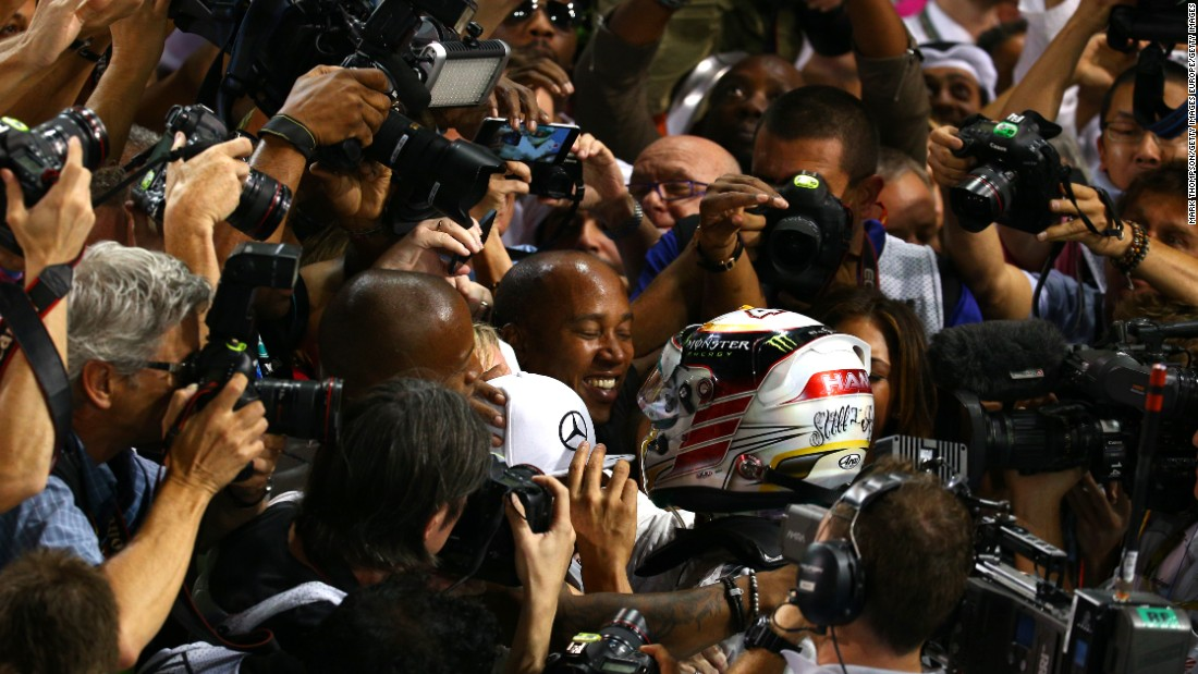 b4158ed68a4c The pair fought off media attention to celebrate the moment Lewis won the  title at the