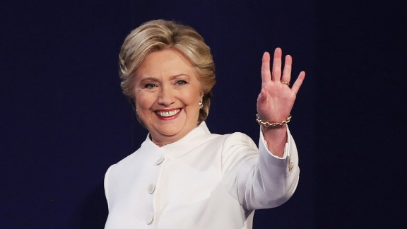 Clinton waves to the crowd before the debate.