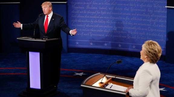 Republican presidential nominee Donald Trump (L) speaks as Democratic presidential nominee former Secretary of State Hillary Clinton looks on during the third U.S. presidential debate at the Thomas & Mack Center on October 19, 2016 in Las Vegas, Nevada.