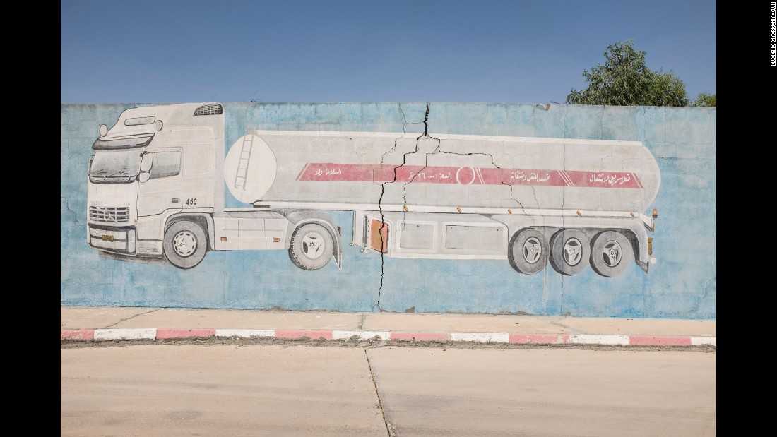 A gas truck is painted on the wall of one station.