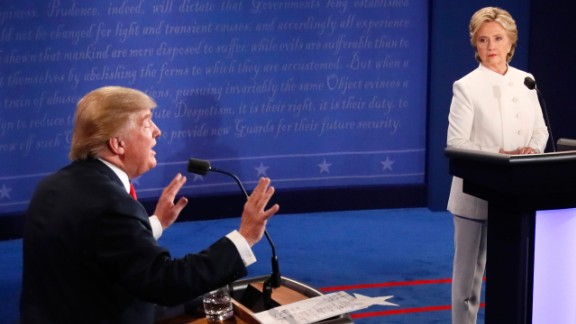 TOPSHOT - Republican nominee Donald Trump gestures as Democratic nominee Hillary Clinton looks on during the final presidential debate at the Thomas & Mack Center on the campus of the University of Las Vegas in Las Vegas, Nevada on October 19, 2016. / AFP / Mark  RALSTON        (Photo credit should read MARK  RALSTON/AFP/Getty Images)
