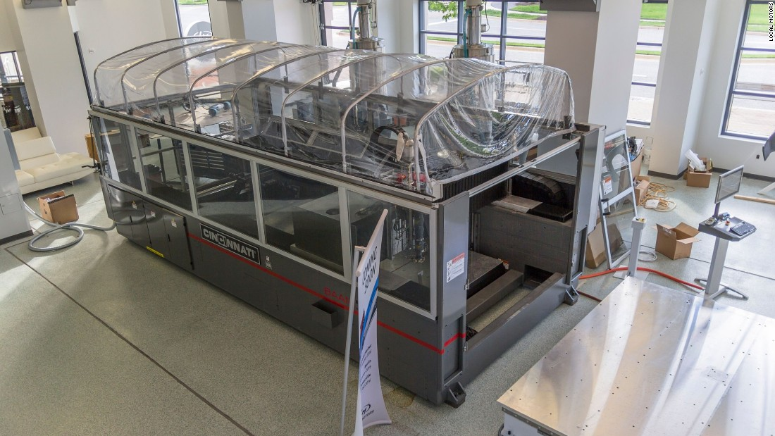 Olli can be produced in two weeks through this 3-D printer. Using printed materials allows Local Motors to scale up production rapidly, and use a lower-carbon production process.