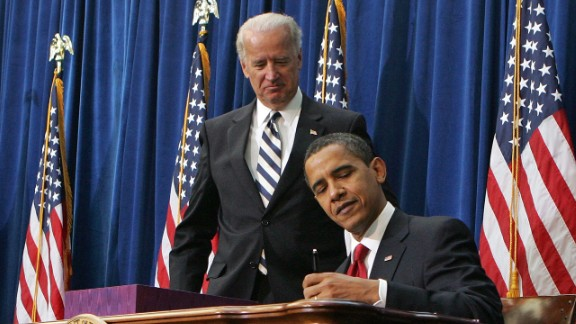 Vice President Joe Biden watches Obama sign the economic stimulus bill on February 17, 2009. The goal was to stimulate the country's staggering economy by increasing federal spending and cutting taxes.