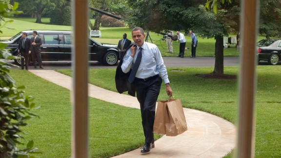 The President returns to the Oval Office after going on a hamburger run for West Wing staffers and aides on May 29, 2009.