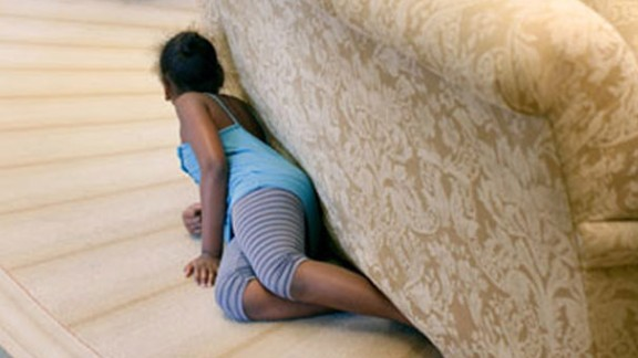 Sasha Obama hides behind an Oval Office sofa as she sneaks up on her father on August 5, 2009. Sasha was 7 when her father took office. Malia was 10. See more pictures of Malia and Sasha Obama since their father was elected President