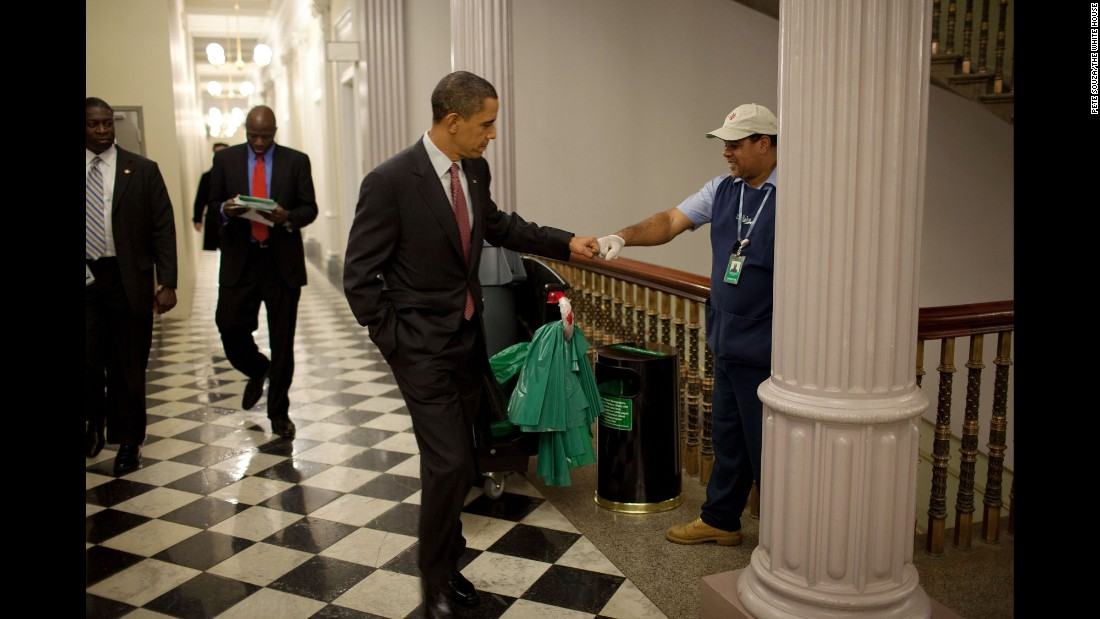 The President fist-bumps custodian Lawrence Lipscomb in the Eisenhower Executive Office Building on December 3, 2009.