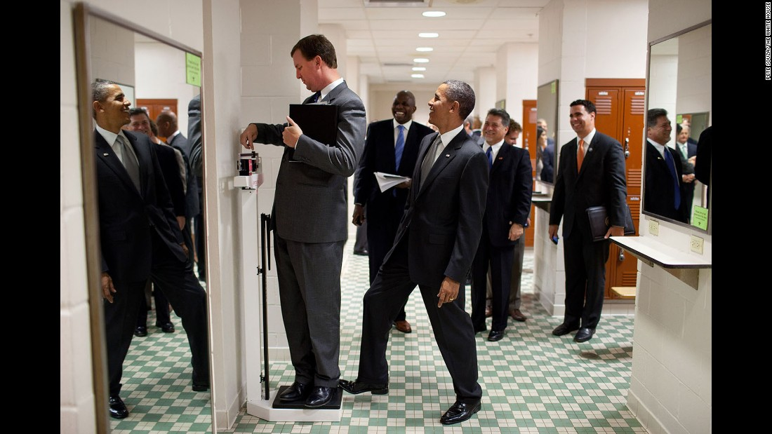 The President puts his toe on a scale as White House travel director Marvin Nicholson tries to weigh himself in Austin, Texas, on August 8, 2010.