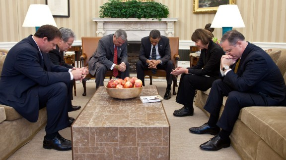 Obama prays in the Oval Office with co-chairs of the National Prayer Breakfast on January 27, 2011. From left are U.S. Rep. Heath Shuler, U.S. Rep. Tom Coburn, U.S. Rep. Jeff Miller, Obama, former Arizona Rep. Ann Kirkpatrick and U.S. Sen. Mark Pryor.