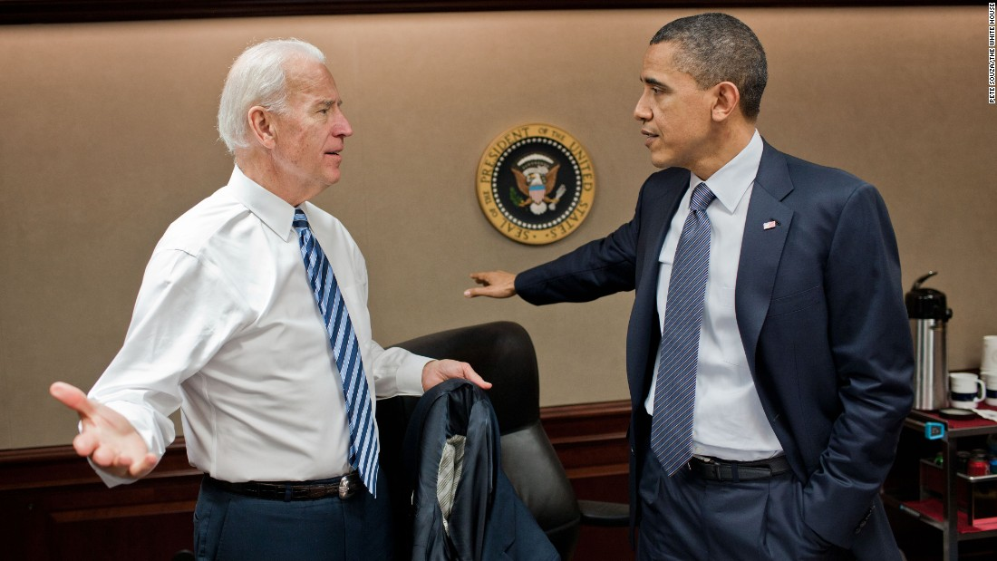 "Obama talks with Vice President Joe Biden after a teleconference call about Libya on April 5, 2011. Obama <a href=""http://www.cnn.com/2011/POLITICS/03/28/us.libya/"" target=""_blank"">committed U.S. forces</a> to the U.N.-authorized mission in Libya, and he told the American people there were strategic and moral reasons to act. Failure to do so, he said, would have allowed Libyan leader Moammar Gadhafi to unleash his military on his own people."
