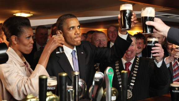 Obama and the first lady enjoy a glass of Guinness as they visit his ancestral home of Moneygall, Ireland, on May 23, 2011. Moneygall is believed to be the birthplace of one of his great-great-great grandfathers.