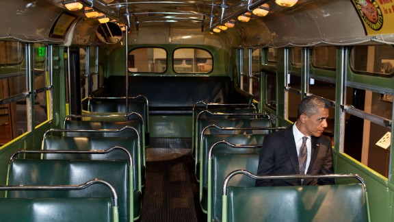 "During an event on April 18, 2012, Obama looks out of the famous Rosa Parks bus that was restored by the Henry Ford Museum in Dearborn, Michigan. ""I just sat in there for a moment and pondered the courage and tenacity that is part of our very recent history but is also part of that long line of folks who sometimes are nameless, oftentimes didn"