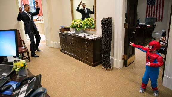 Obama pretends to be caught in Spider-Man