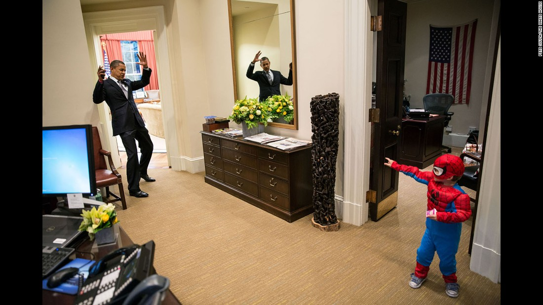 "Obama pretends to be caught in Spider-Man's web as he interacts with Nicholas Tamarin, 3, just outside the Oval Office on October 26, 2012. Nicholas, son of White House aide Nate Tamarin, had been out trick-or-treating. ""The President told me that this was his favorite picture of the year when he saw it hanging in the West Wing a couple of weeks later,"" White House photographer Pete Souza said."