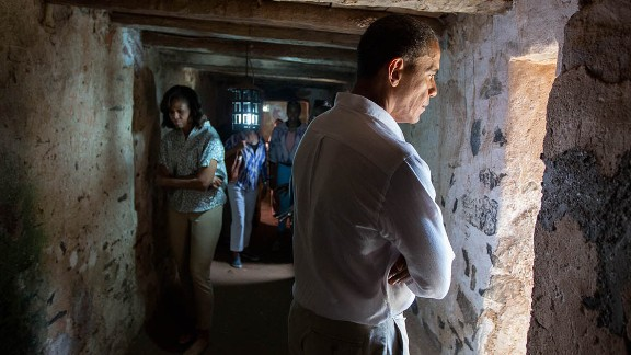 Obama and the first lady tour an old slave house on Senegal