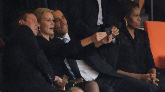 Obama and British Prime Minister David Cameron pose for a selfie with Danish Prime Minister Helle Thorning-Schmidt during Nelson Mandela